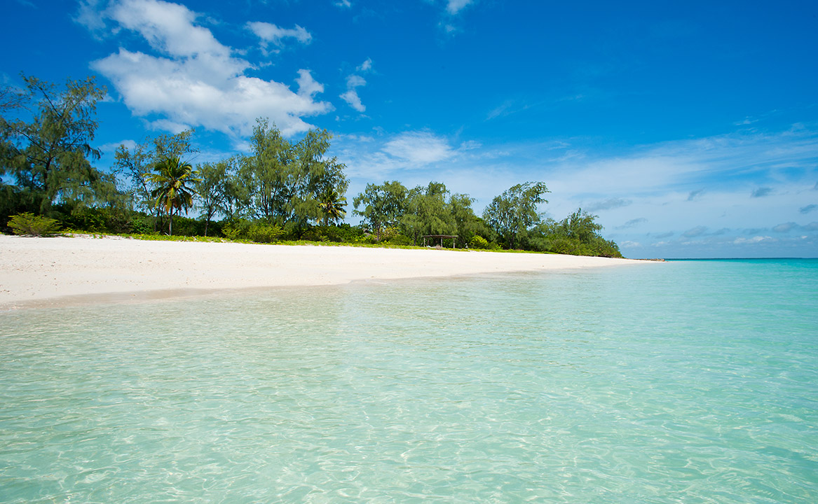 One the 10 secluded beach villas in the Vamizi Island Lodge as seen from the warm waters of the Indian Ocean.